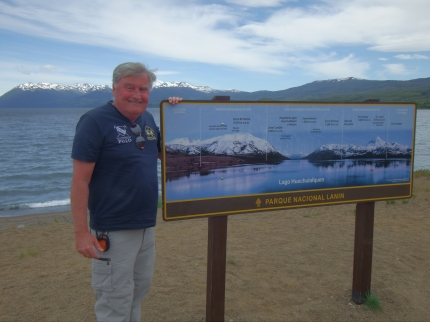 Jack Standing Next to the sign on Lago Huechulafquen 11-2014.JPG